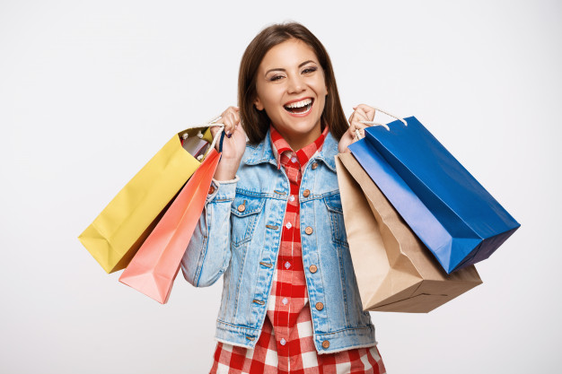 stylish young woman posing with shopping bags after great shopping 176420 9041