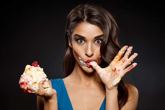 cheerful woman blue dress eating piece cake 176420 3536