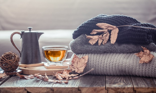 cozy autumn still life with cup tea decor items living room home comfort concept 169016 4579