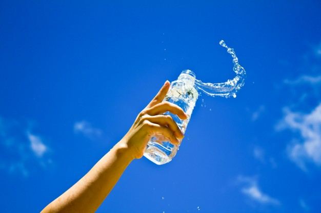 human hand holding bottle water 1232 4373