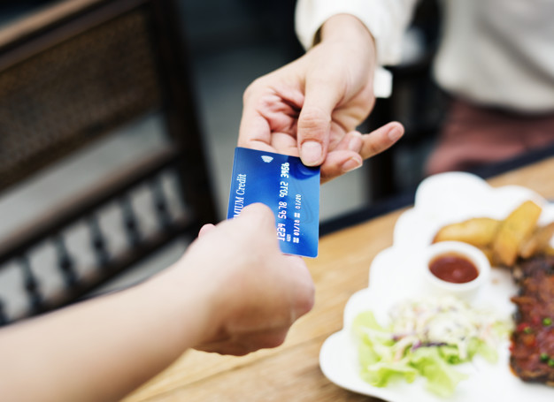 woman paying lunch with credit card restaurant 53876 24967