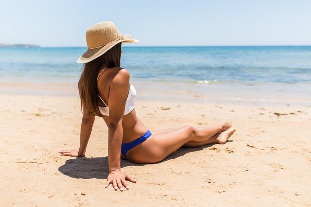 young latin woman straw hat sitting sea beach 231208 5367